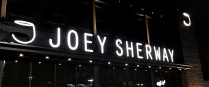 Storefront sign for Joey Sherway restaurant.