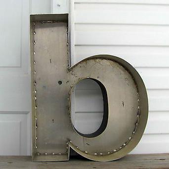"A rustic hollow ""b""."