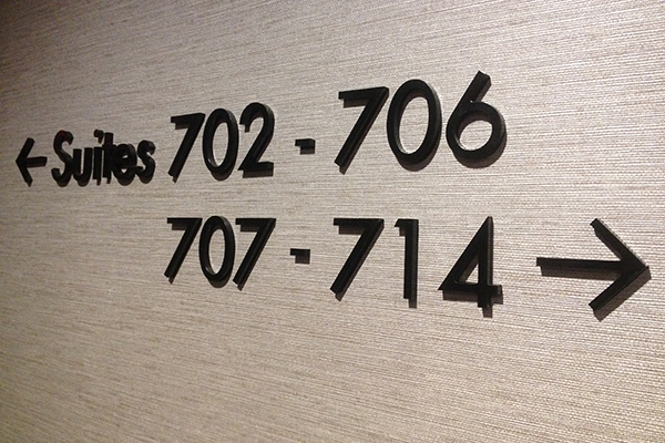 The channel letters we made and installed for a condo's suite numbers.