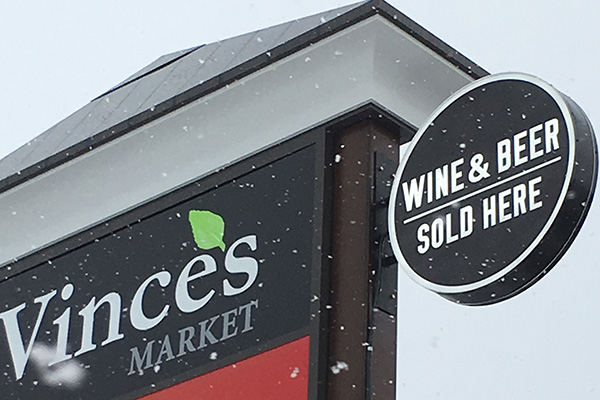 Exterior sign for a wine & beer store.
