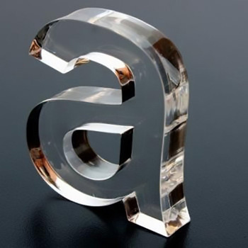 "Clear acrylic lowercase ""a"" made by Sign Nation Toronto."