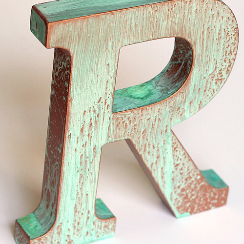 "Copper patina letter ""R""."