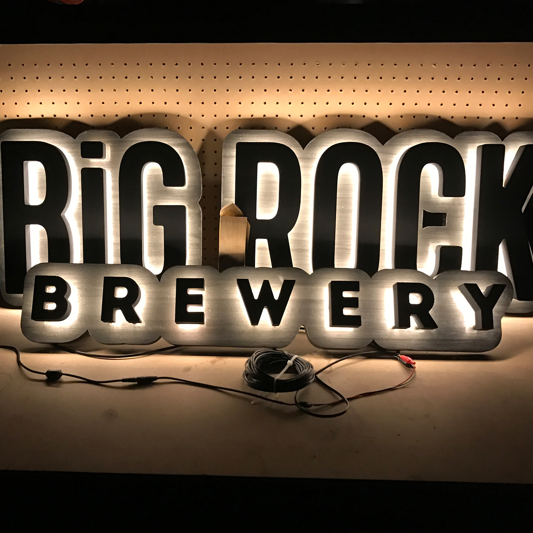 """""""Big Rock Brewery"""" business sign with a halo on backer design."""