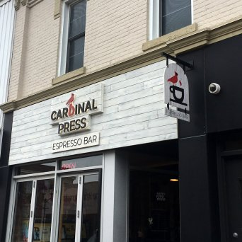 The storefront sign for Cardinal Press.