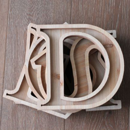 4 Wood channel letters stacked on top of each other.