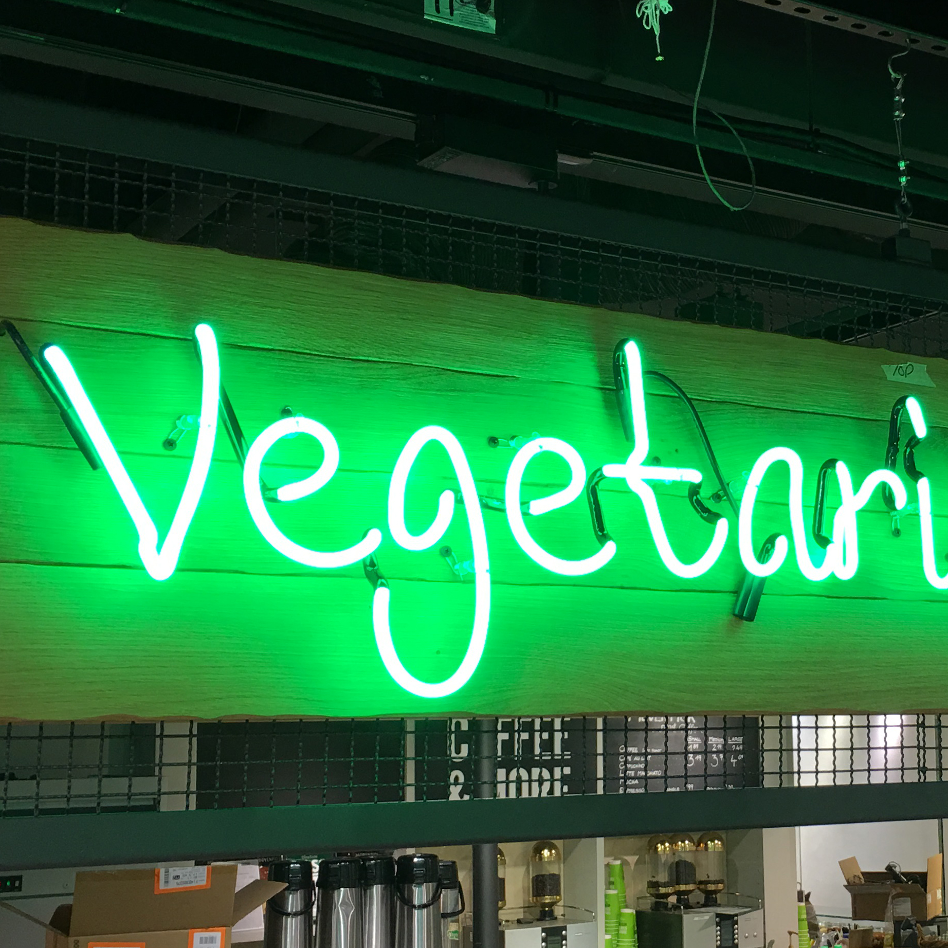 "A neon sign that says ""vegetarian."""