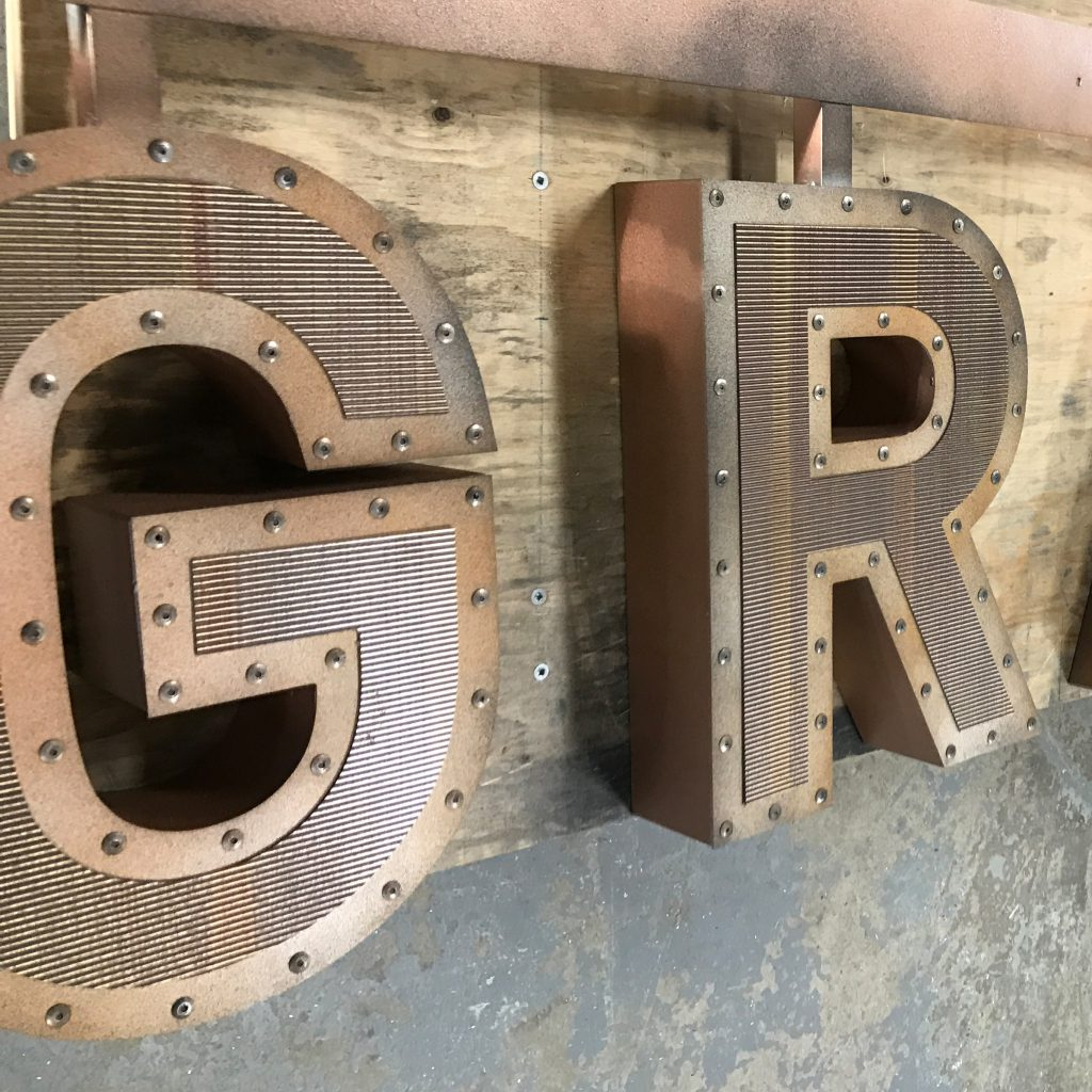 Studded letters that spell