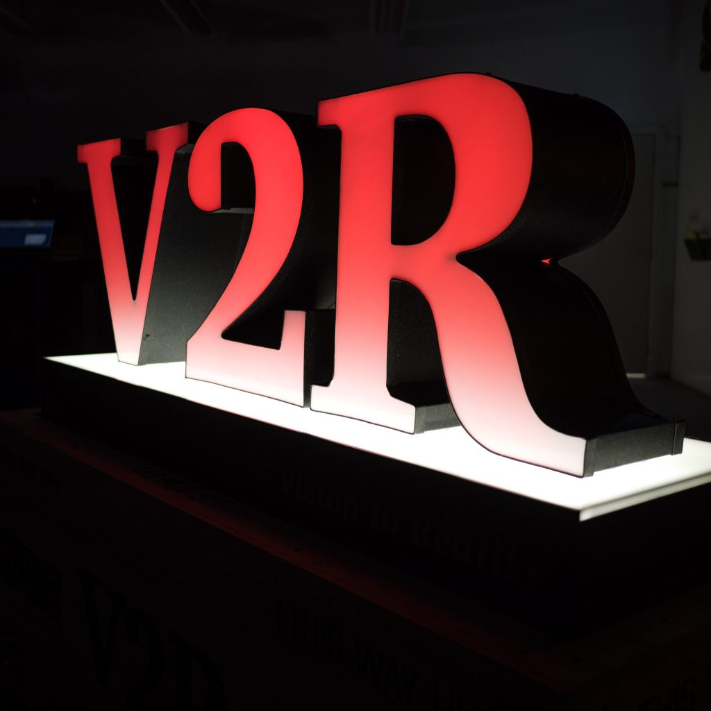 The red 3D channel letters for V2R.