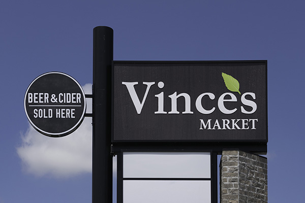 Outdoor sign for beer and cider.
