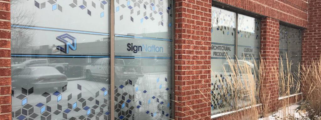Logo on windows at Sign Nation.