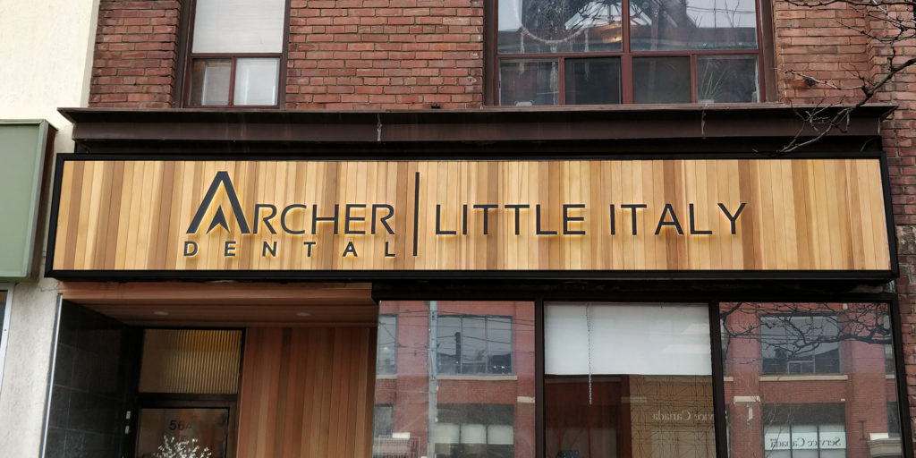 half halo lit signage with wood backer