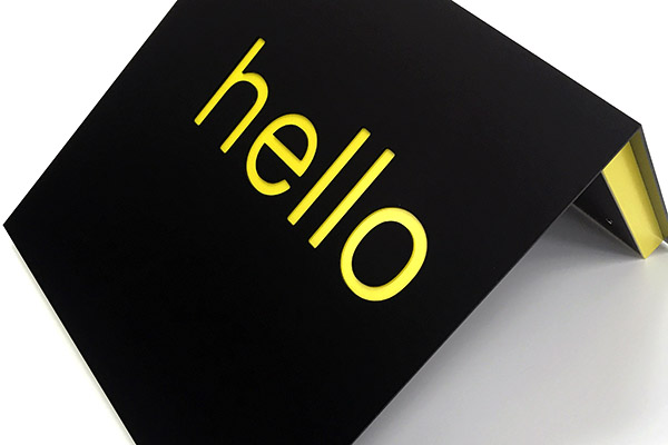 Yellow hello reception signage