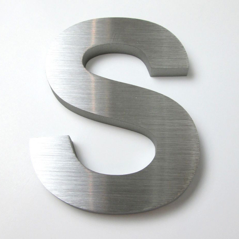 """A big stainless """"S"""" letter."""